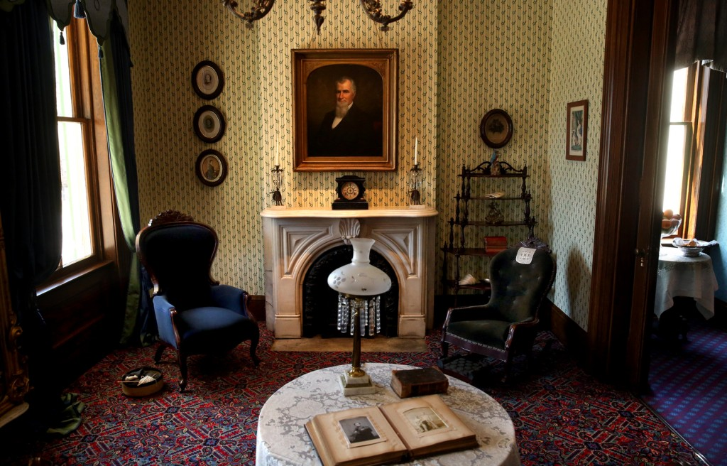 In the Sitting Room, new oak-leaf patterned wallpaper covers the walls along with new carpeting, recessed lighting and other imporovements. An oil painting of Benjamin Edwards can be seen over the fireplace. Renovations are nearly complete on the first floor rooms at Edwards Place in Springfield, home of attorney Benjamin Edwards, son of Ill Governor Ninian Edwards and brother-in-law to Mary Lincoln's sister Elizabeth. Part of the Springfield Art Association complex, public tours for the antebellum mansion are scheduled to resume April 21 after a nearly $500,000 restoration project begun over a year ago has brought the home up to its mid 19th Century appearance. Money for the project came from private donors and the Jeffris Family Foundation, with fundraising ongoing for future renovation of 2nd story rooms. Photographs taken during home tour on Tuesday, Mar. 31, 2015. David Spencer/The State Journal-Register
