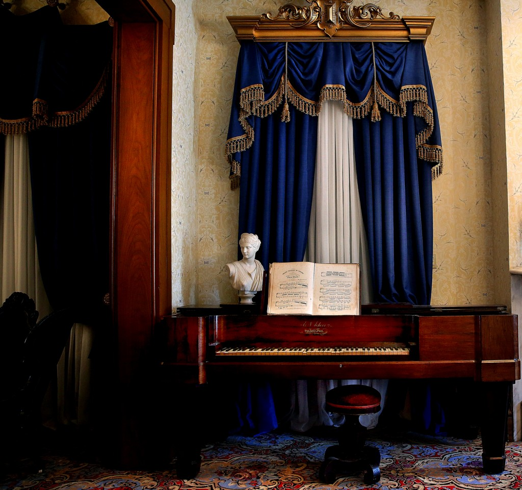 A Roman bust of Diana, goddess of the hunt, is displayed atop an 1850's era square grand piano made by E. N. Scherr of Philadelphia on display in one of the home's formal parlors. Renovations are nearly complete on the first floor rooms at Edwards Place in Springfield, home of attorney Benjamin Edwards, son of Ill Governor Ninian Edwards and brother-in-law to Mary Lincoln's sister Elizabeth. Part of the Springfield Art Association complex, public tours for the antebellum mansion are scheduled to resume April 21 after a nearly $500,000 restoration project begun over a year ago has brought the home up to its mid 19th Century appearance. Money for the project came from private donors and the Jeffris Family Foundation, with fundraising ongoing for future renovation of 2nd story rooms. Photographs taken during home tour on Tuesday, Mar. 31, 2015. David Spencer/The State Journal-Register