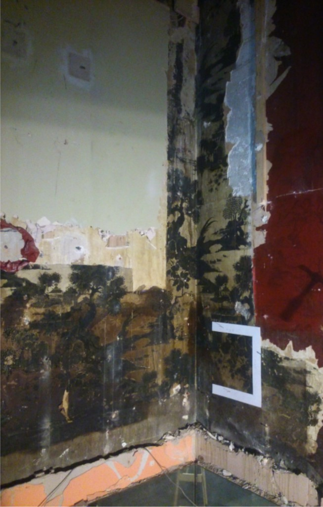 Smoke-damaged fragments of 1920s wallpaper, found during renovation.